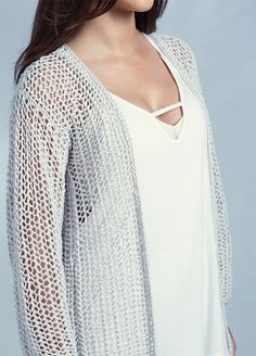 Free Easy One Row Repeat Longline Cardigan - This easy sweater is knit with a one row repeat mesh stitch and minimal shaping. Worsted weight yarn. SizesXS(S,M,L,XL, XXL). Designed byQuail Studio