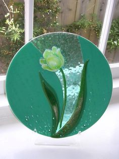"Lovely White Tulip on Jade - 14"" kiln-formed tulip design by the artist, Donna Sarafis. Piece includes cut glass, frit, stringer, and a multi-dimensional technique to create texture, then slumped into a shallow mold."