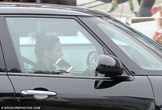 Talking at the wheel? Rachel Stevens appeared to break the law by getting behind the wheel of her car whilst using a mobile phone