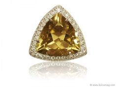 Eavesdrop on a whisky coloured trifecta of 18-karat white gold, trillium-cut lemon stone and round brilliant-cut diamonds.