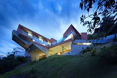 This residence located in Nova Lima, Brazil,surprises with its extreme architecture. This solution is dictated on the one side by the steep slope of the site and on the...
