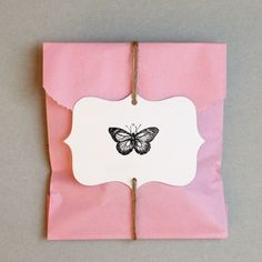 Butterfly-themed favor packaging - photo by muchwisor | Photobucket