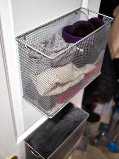 Tiny spots in closet or back of the door. use for small things, scarves, belts, hats, you can even pin earrings to them.