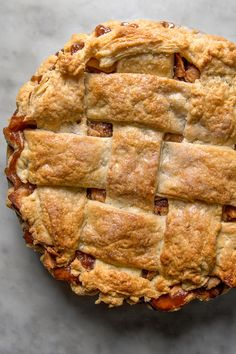 NYT Cooking: This recipe is a keeper. Gently spiced with cinnamon, tinged with brown sugar and loaded with apple butter, it's as deeply flavored as an apple pie can be, all covered with a buttery wide-lattice top crust. Although it's at its most ethereal when baked on the same day you serve it, it's still wonderful made a day ahead. (Don't let making your own pie crust intimida...