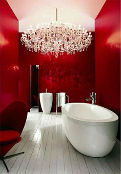 All red walls, white wood floor
