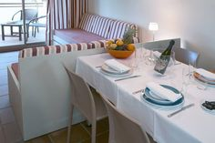 Comfortable and practical apartments persons and persons. Apartments, Table Settings, Place Settings, Flats, Table Arrangements, Desk Layout