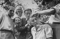 Female French collaborator having her head shaved during liberation of Marseilles.