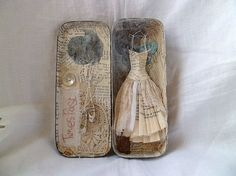 by Messie Jessie / assemblage -altered tin with paper dress. by glenda Altered Tins, Altered Art, Paper Dolls, Art Dolls, Paper Art, Paper Crafts, Matchbox Art, Tin Art, Altoids Tins