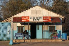 "Blue Front Cafe    The Blue Front Cafe is one of the last real juke joints left in Mississippi. The man on the right is Jimmy Holmes, who introduced himself as ""Duck"" and owns the cafe. He was very humble, saying that he could not host more music due to air conditioning issues but that I should still take a look around inside. He is apparently the last practitioner of the Bentonia blues style and was recorded by noted folklorist Alan Lomax."