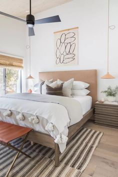 Adding a tapestry or unframed canvas to your bedroom can create a nice focal point. We've got more bedroom wall decor ideas to help you elevate your space in this post.