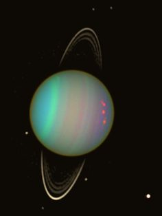Wider View of Uranus - Faint rings and six satellites are captured in this image. Ariel - lower right corner. Clockwise from top - Desdemona, Belinda, Portia, Cressida and Puck