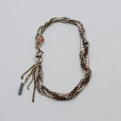This plaited piece was made using a variety of vintage gold, silver and copper tone chains, plaited . Vintage Necklaces, Handmade Necklaces, Plaits, Unique Vintage, Sustainable Fashion, Beaded Necklace, Copper, Chain, Beads