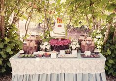 love this sweets table - great cake and cakestand with flowers and the stumps to get different levels