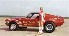 Bunny with the car that she raced in the Miss Universe of Drag Racing tour, in the late ' 60s and early ' 70s.