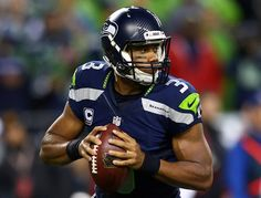 SEATTLE, WA - SEPTEMBER 15:  Russell Wilson #3 of the Seattle Seahawks looks to throw the ball against the San Francisco 49ers during their game at Qwest Field on September 15, 2013 in Seattle, Washington. Credit: Getty Images