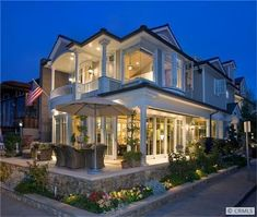 I love all the patios and porches on this house on Balboa Island in CA