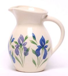 Our Field of Iris Iced Tea Pitcher is part of our Field of Iris Collection. A combination of blue, periwinkle, and plum highlight this Iced Tea Pitcher. Hand Painted Pottery, Ceramic Pottery, Iced Tea Pitcher, Pottery Painting Designs, Matcha Green Tea Powder, Ceramic Pitcher, Ceramic Painting, Painted Ceramics, Jars