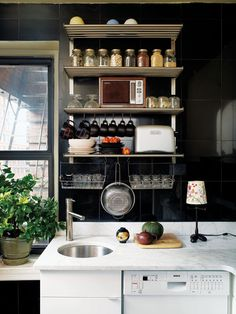 Keeping with today's Black & ... theme: black and steel in the kitchen.  Stylishly functional.  I'd love to swap my oppressive wood cabinets for some spare industrial shelving.
