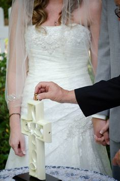 Unity Cross Ceremony-- Love the bride and groom holding hands!