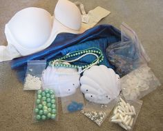 Supplies for making a mermaid bra..., maybe a kid version of these for a party craft ?