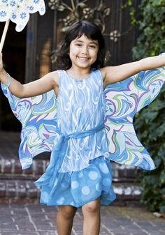 These special girls dresses transform into a butterfly or fairy.  Just put your fingers through the loopholes and voila!