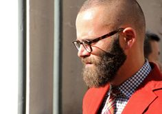 LOVE - the GLASSES, checked SHIRT, plaid TIE, & color-pop BLAZER.  HATE - the beard (especially w/ an almost shaved head); is he handsome under all that fuzz? How long does he pick out food after eating - does he have to shampoo or just use a napkin & brush? Do I get a mouthful of fuzzy-wuzzy if he kissed me? EWWWWW (ParisFashionWeek)