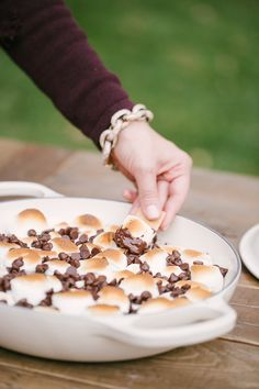 Serving something sweet to close out the event will ensure that your guests leave with a smile on their faces. What backyard barbecue party would be complete without s'mores?! Get 6 tips for hosting a backyard engagement party.