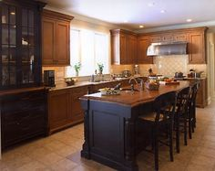 hopefully what my kitchen will look like w/ black island and oak cabinets.