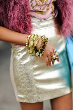 spiked bracelets, pink fur, silver mini skirt