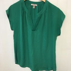 Emerald Green Top Beautiful cap sleeve top• see photos • great condition • cleaned and ready to ship• fits med to lg (med best) • ask any questions prior to purchase• no trades /no pp @keg90 Roz & Ali Tops Blouses