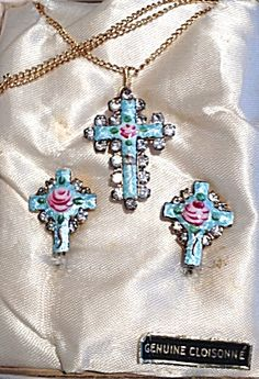 $159 GORGEOUS vintage Rhinestone cross necklace and earring set in a blue guilloche enamel with a pink rose and green leaves in the center. The cross pendant and cross shaped screw back earrings are surrounded by faceted prong set rhinestones. The back of the pendant and the earrings each have a religious oval shaped gold tone Miraculous medal featuring The Blessed Mother Virgin Mary as Our Lady of Grace / Immaculate Mary.