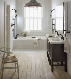 Walk through shower to get to bathtub.  Neat idea.  Not sure the glass shower walls would keep the floor from getting soaked.  Maybe have tile floor gently sloped back into the shower area?