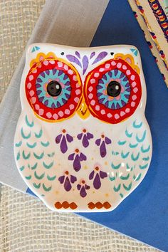 Large owl eyes, colorful wings, and colorful markings make this precious ceramic trinket dish a delight in any kitchen! Whether for you or for a friend, this trinket dish will make an excellent catch-all dish or spoon rest.<br /> <br /> - Imported