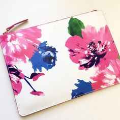 Kate Spade floral clutch Floral Gia from Kate Spade. Use it as a clutch or a pouch. Brand new with tag. No trades. No PayPal. kate spade Bags Clutches & Wristlets