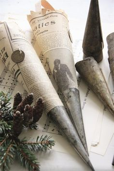 Christmas decor. What are these wonderful metal cones???? I wonder if I could make cones from thin copper sheeting? Cut out with a lip to fold over with needle-nosed pliers. If I could find or make a form to mold around, it would be even better. Thin sheet metal of any kind could work, and patinas could be applied.