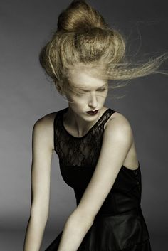 "CosmoProf This top-knot tidies and smoothes the ""messy"" bun, but leaves a few stray crimped strands for movement and a natural softness."
