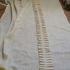 Create pleated burlap curtains.