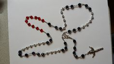 A husband and wife adopted two children out of LOVE.  The grandmother chose to honor that with this rosary!