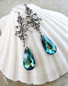 Sterling silver fleur-de-lis earrings with pear-shaped blue quartz stones
