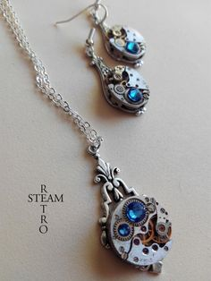 Items similar to Steampunk Jewelry set in Sapphire - Steampunk wedding set - Steampunk Necklace & Earrings - Christmas gift - Gift for her on Etsy Steampunk Wedding, Gift Sets, Wedding Sets, Fascinator, Sapphire, Brass, Pendant Necklace, Deco, Silver