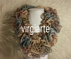 A very simple way to make a Scarf using Sashay Yarn and a Crochet hook. When you're finished watching the video, be sure to visit my. Loom Knitting Stitches, Knitting Patterns, Crochet Scarf Youtube, Sashay Yarn Projects, Grapevine Wreath, Burlap Wreath, Easy Crochet, Crochet Top, Sashay Scarf