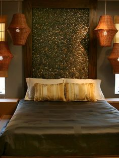 Stone Mosaic behind the bed and look at the lanterns~