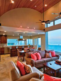 The focus is on the sand and coral colors - a modern take on a beach house/coastal retreat.