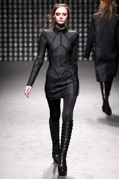 Gareth Pugh Fall Winter 2011. Exaggerated shoulder with tone-on-tone geometric lines.