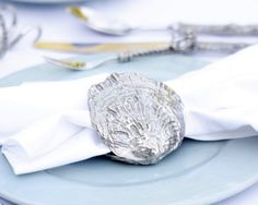 Clam Shell Napkin Ring No will clam up at your table when you finish your marine design with our elegant pewter Clam Napkin Rings. Cast with high quality Vagabond House pewter, these clams are a testa