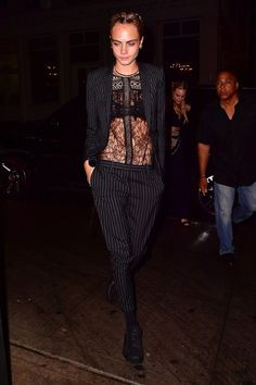 For her evening look she teamed the same lace blouse with a pinstripe trouser-suit.