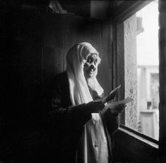 Woman reading a letter in the doorway, District Six, Cape Town, South Africa Cities In Africa, Woman Reading, Most Beautiful Cities, African History, Doorway, Cape Town, Old Photos, South Africa, Suitcase