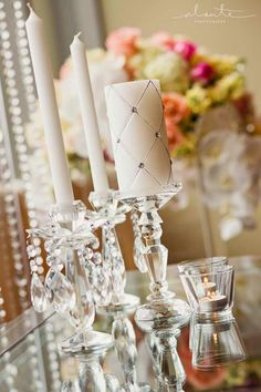 Cut down on floral expensive by using more flowers, only no tealights in silver cups, either use clear cups in clear holders or full size votives | Flora Nova Blog