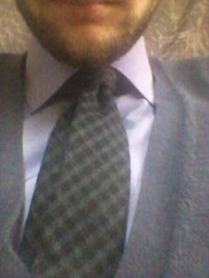 Black&gray plaid whool tie + purple shirt + dark purple cardigan