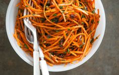 Lemony Carrot Slaw // For a refreshing uncooked side dish with a touch of sweetness, try this quick slaw. Chewy currants and flecks of fresh parsley and mint complement the warm spices and cool carrots. Make the slaw a day ahead to let the flavors blend together. For a Moroccan touch, add a splash of rose water. It's a fantastic vegan side dish for your spring gathering!